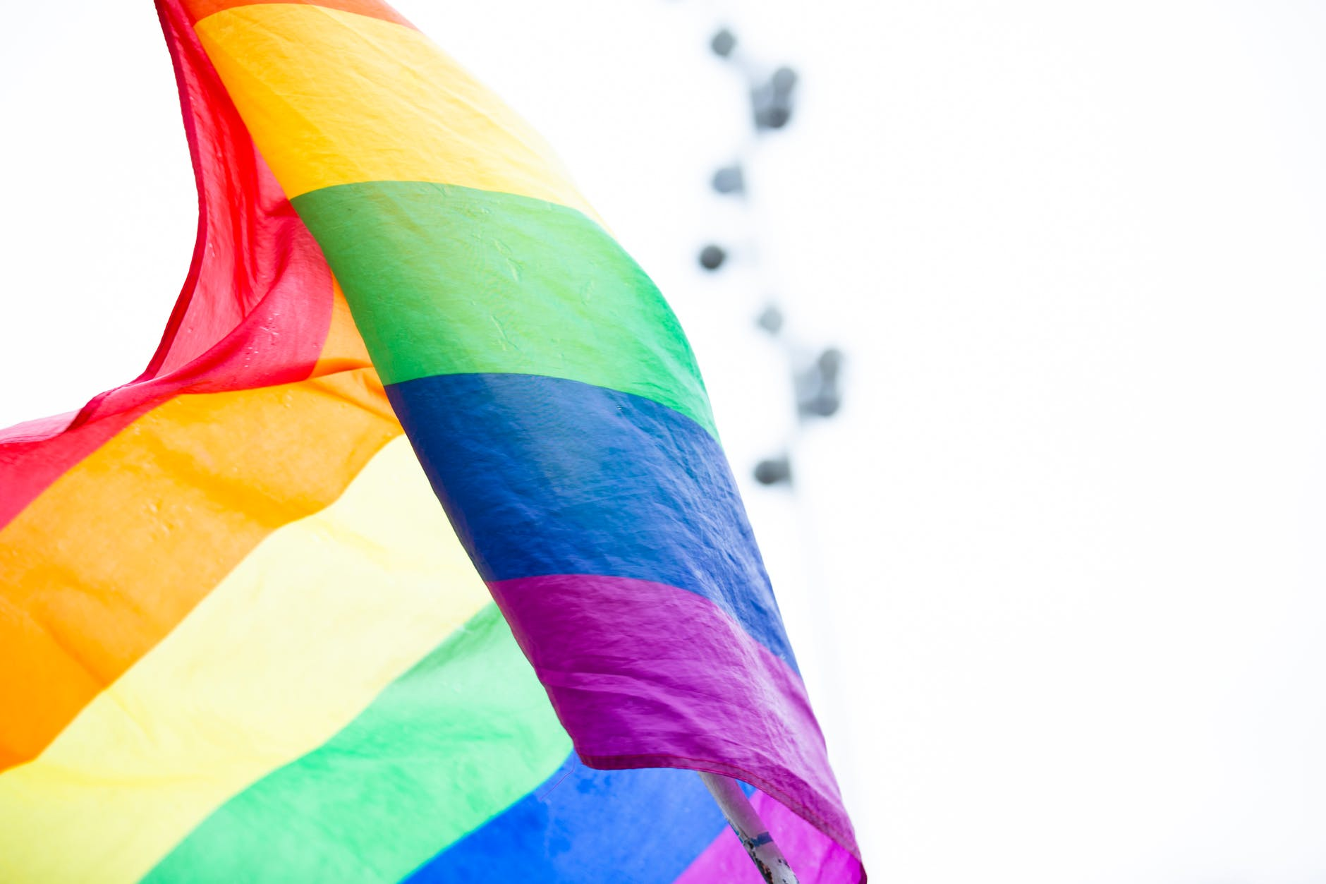 selective focus photography of waving pride flag